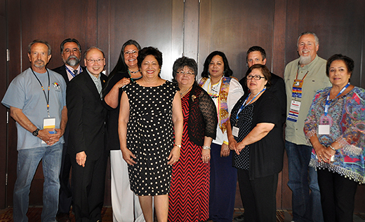 Director Archuleta takes a photo with SAIGE members at their national training in Albuquerque, New Mexico