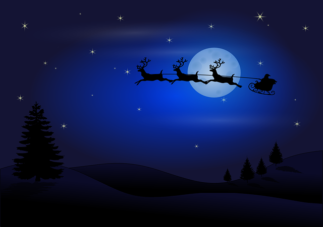 Santa Claus flies through the sky with his reindeer.