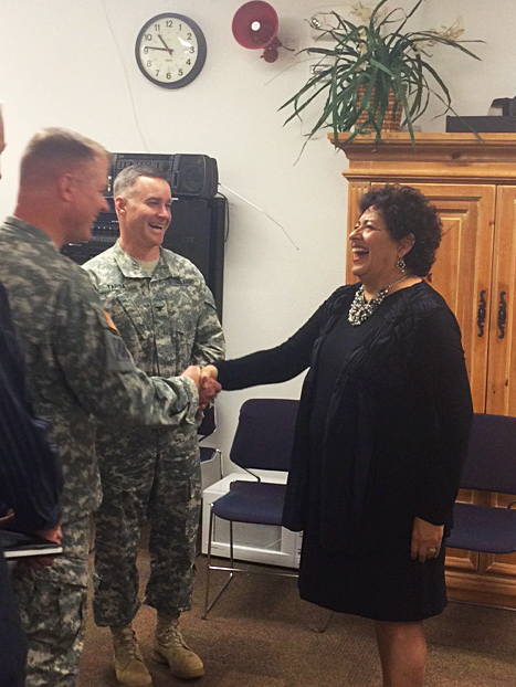 Director Shaking Hands with Soldier and Laughing with other soldier in background.