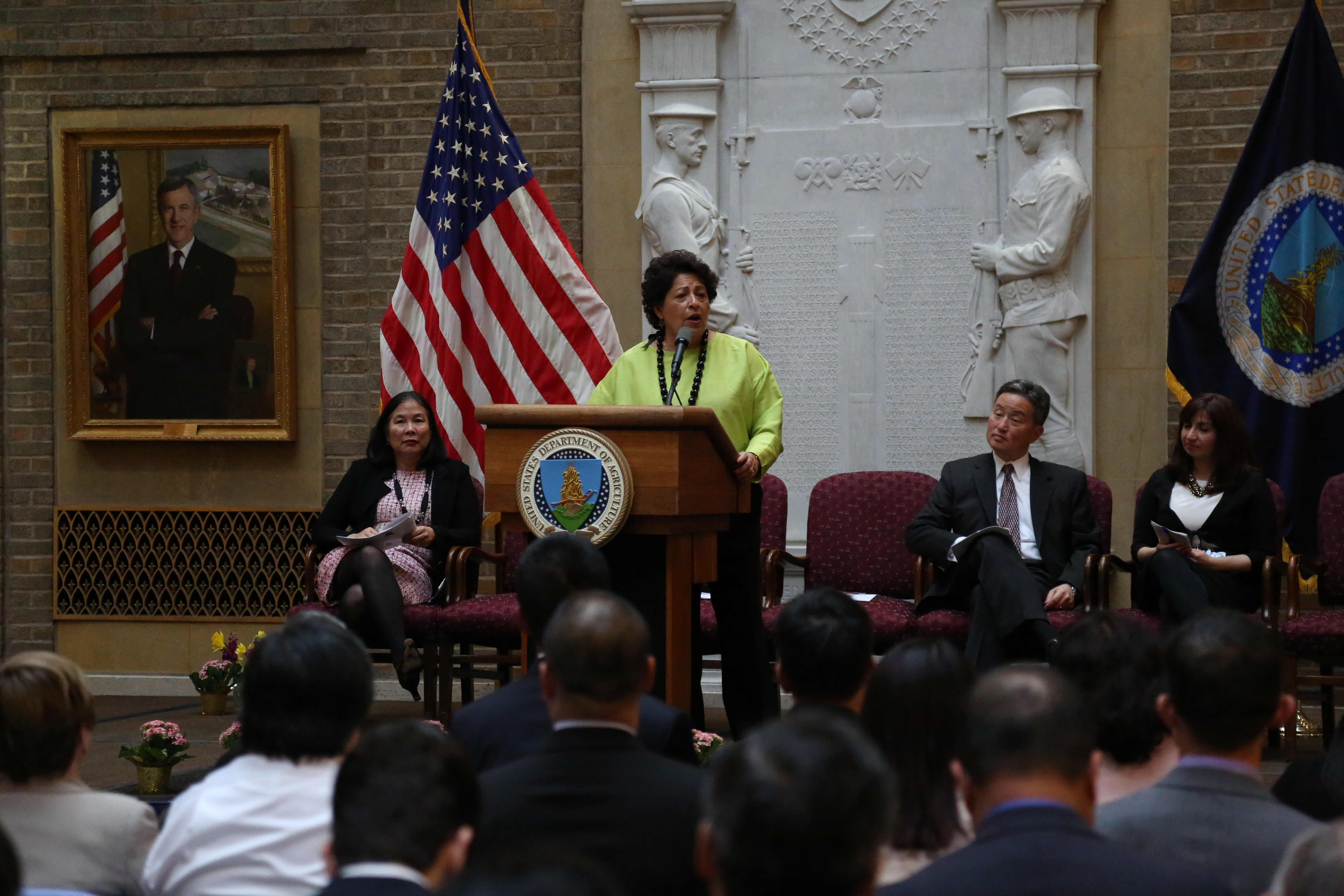 Director Archuleta Speaking on stage at an AAPI event