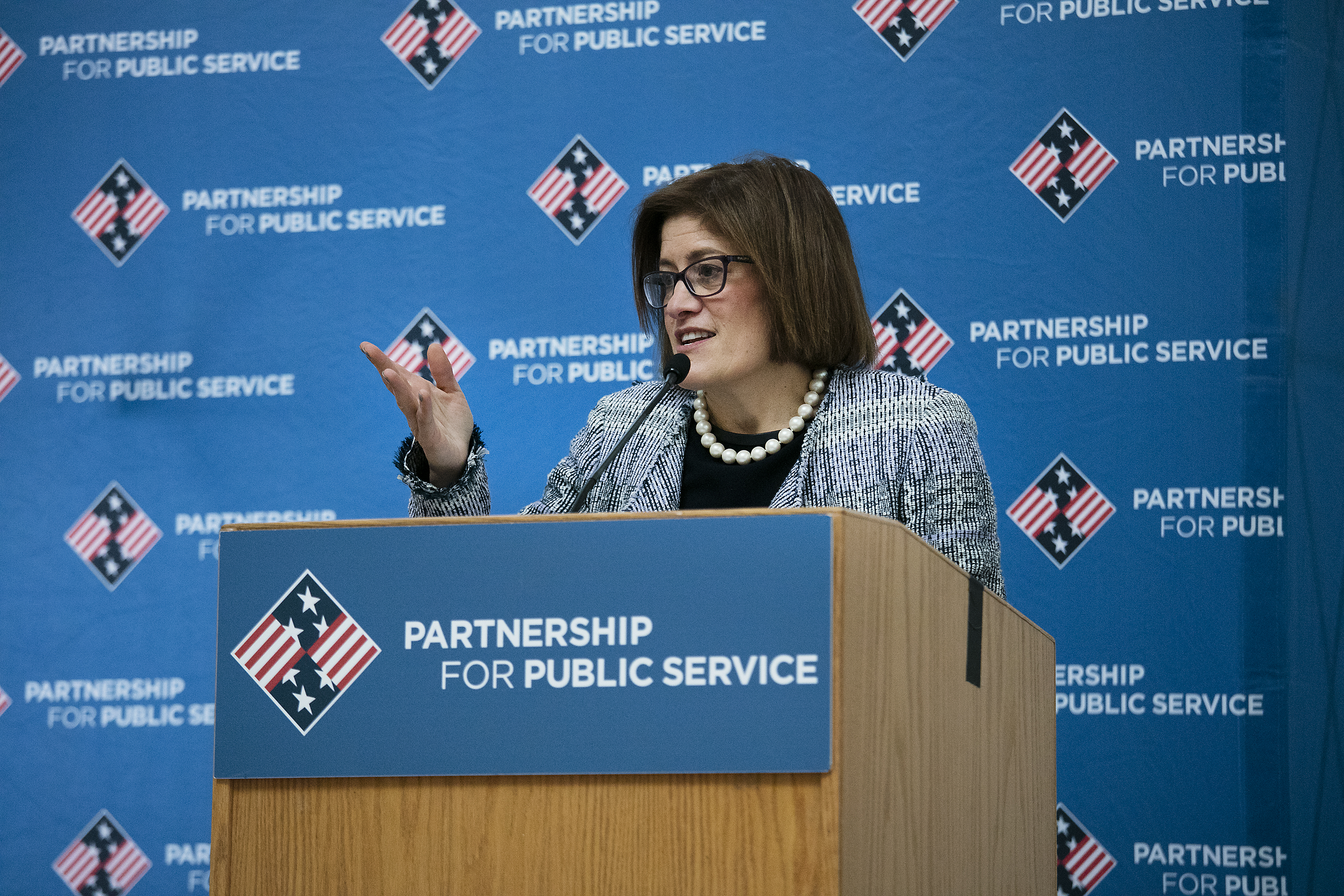 Photo of Acting Director Cobert addressing agencies at a Partnership for Public Service celebration.