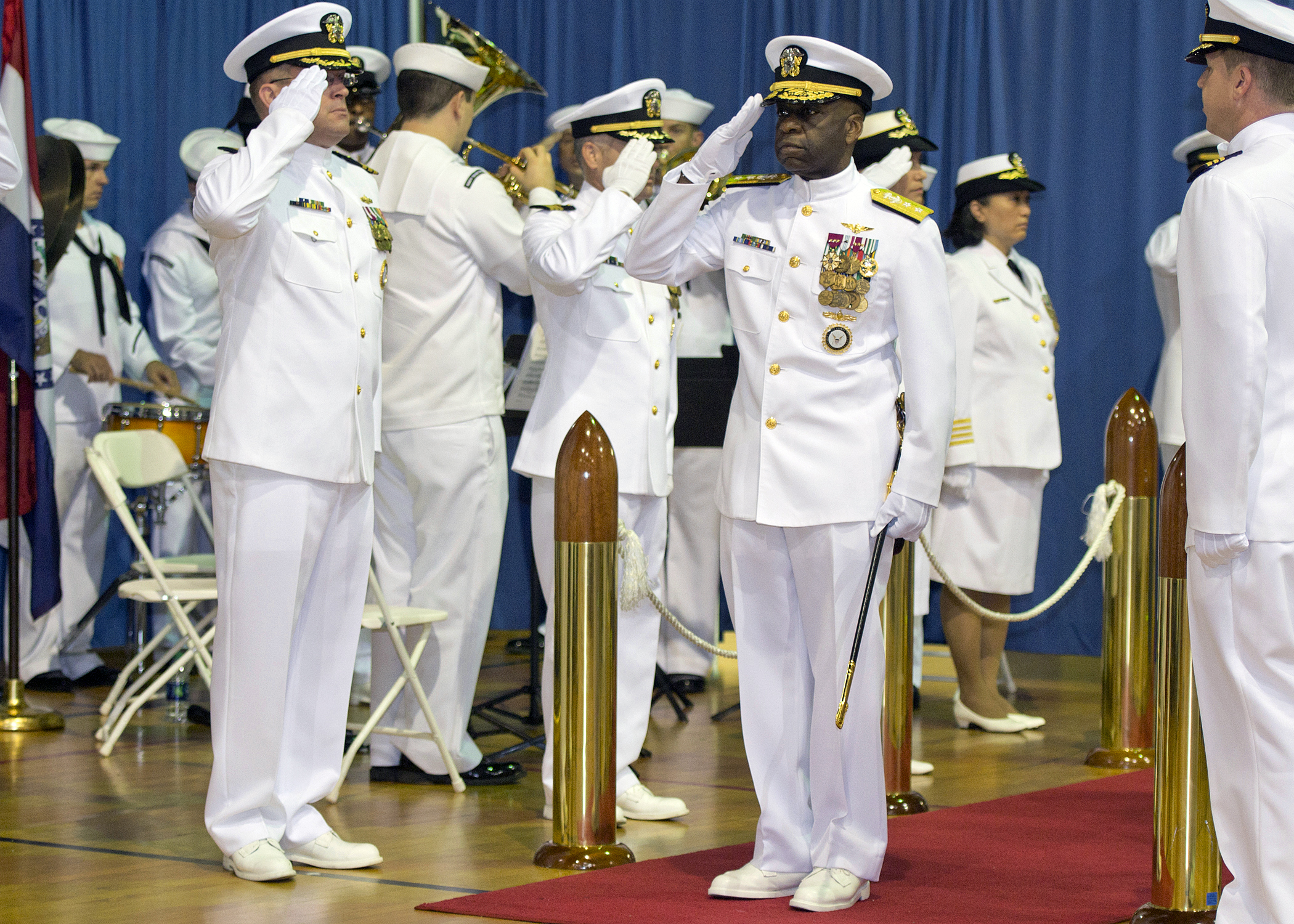 Admiral Earl Gay salutes in uniform.