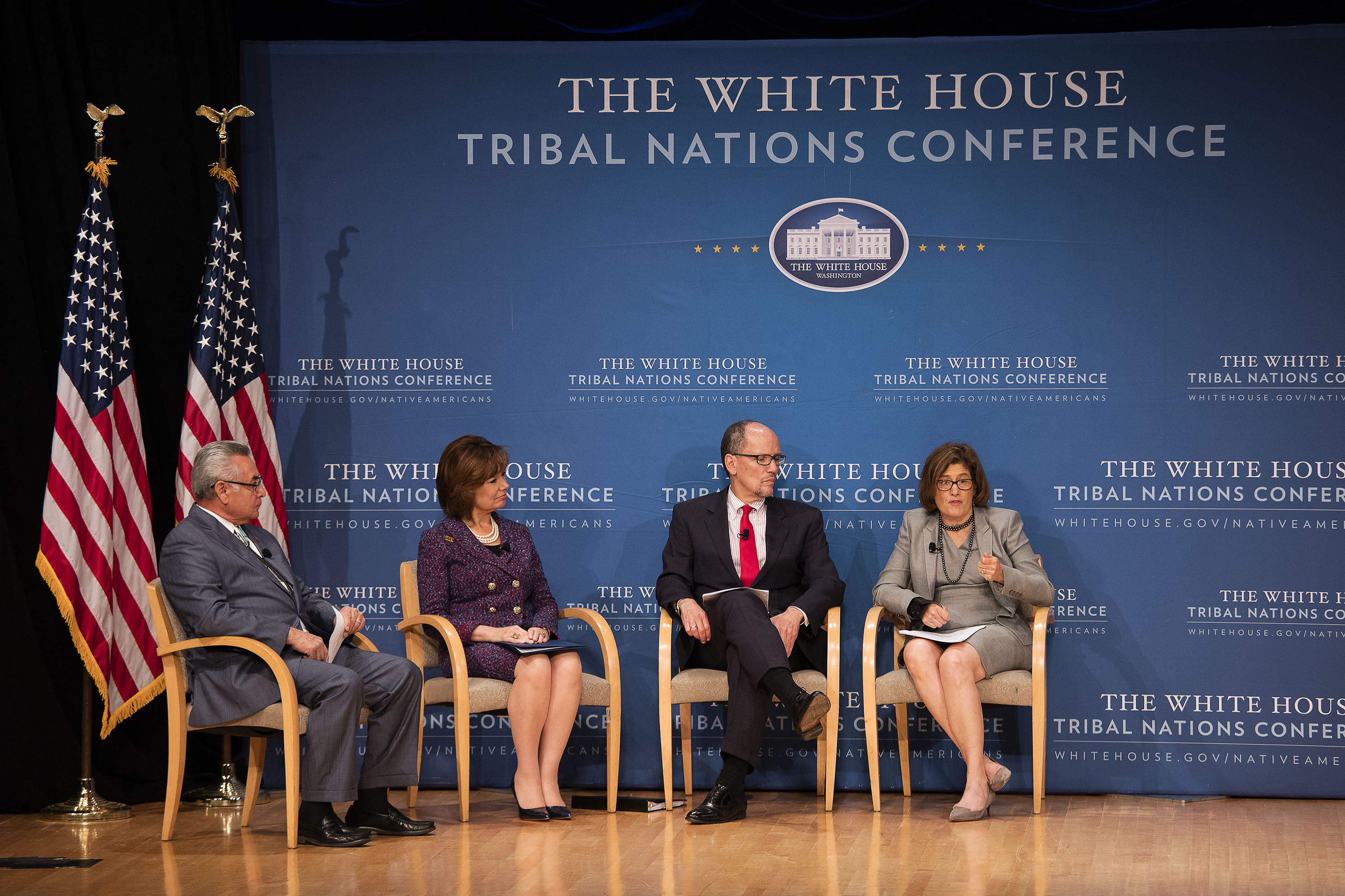 Four people sit on state at White House Tribal Nations Conference. Beth Cobert is the last person on the right.