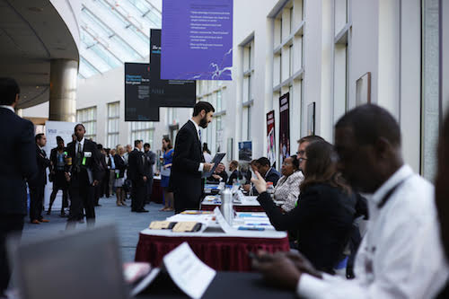 PMF 2015 finalists participate in a job fair at the NIH conference center.