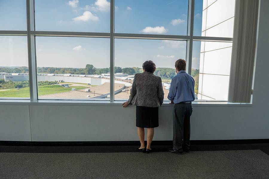 Director Archuleta looks out the window at Argonne National Laboratory