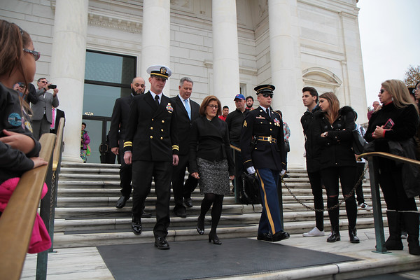 A picture of Acting Director Cobert walking down the steps Tomb of the Unknown Soldier
