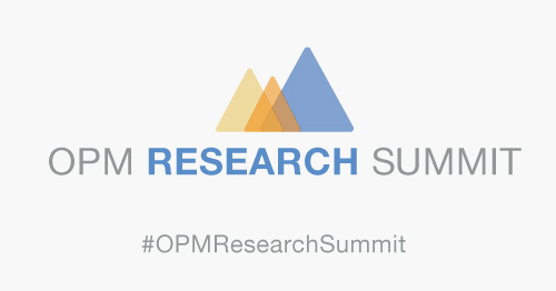 In the middle of image there is the text OPM Research Summit in white and gray with the logo on top, three overlapping triangles, first a medium light yellow triangle, and a small dark orange triangle, and last a large blue triangle. Underneath is the text #OPMResearchSummit