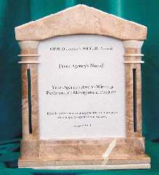 photo of award item: marble pillar frame inscribed on smoked-glass insert with recipient's organizational name and name of award-winning program
