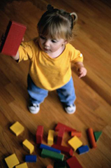 Image of a child playing with blocks